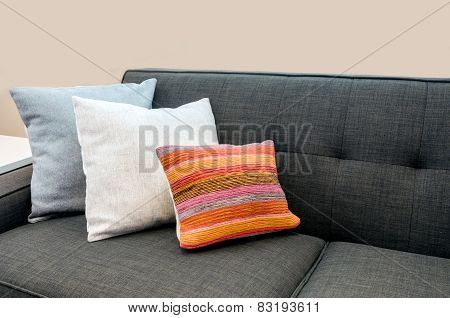 Colorful designer pillows on a sofa