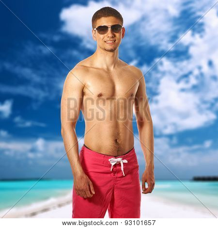 Man on beach with sandspit at Maldives. Collage.