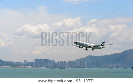 HONG KONG - JUNE 04, 2015: Cathay Pacific aircraft landing. Cathay Pacific is the flag carrier airline of Hong Kong, with its head office and main hub located at Hong Kong International Airport