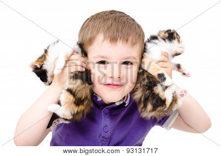 Portrait of a happy boy playing with kittens