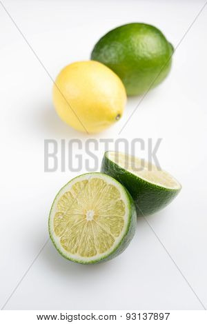 Fresh cut lime with lemon - isolated