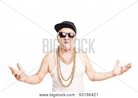 Cocky senior man in a hip-hop outfit gesturing with his hands and looking at the camera isolated on white background