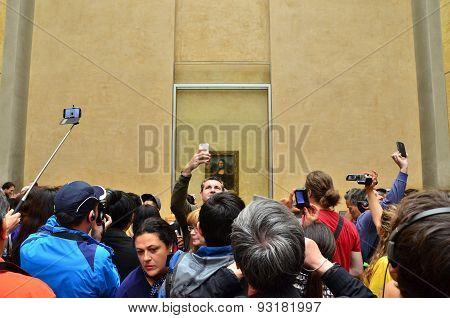 Paris, France - May 13, 2015: Visitors Take Photos Of