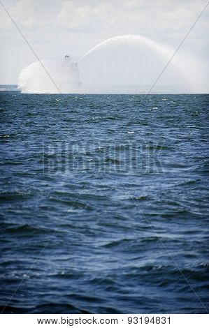 Fireboat In Action On The Sea