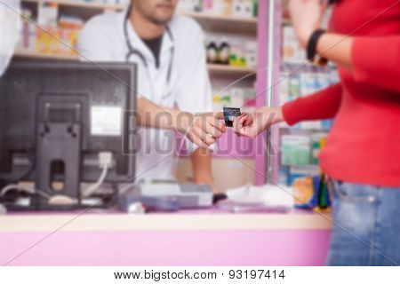 Business Relations In Pharmacy Paying With Credit Card