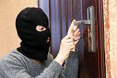 Burglar breaking into house poster