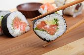 japanese sushi and chopsticks close-up, food background poster