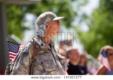 MERIDIAN IDAHO/USA - JULY 30 2016: Service member with his flag in support for the Meridian Police department
