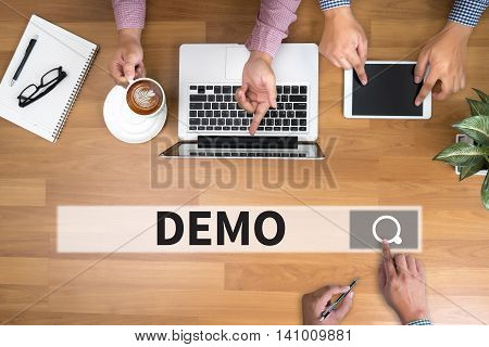 DEMO (Demo Preview Trailer Trial Ideal) man touch bar search and Two Businessman working at office desk and using a digital touch screen tablet and use computer objects on the right top view poster