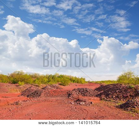 red land with heaps and view on the sky in Krivyi Rih, Ukraine