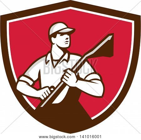 Illustration of a professional male carpet cleaner worker holding vacuum cleaner looking to the side viewed from front set inside shield crest on isolated background done in retro style.