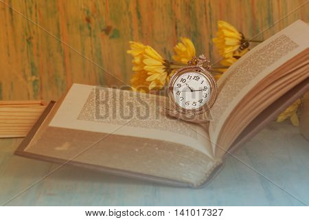 Pocket Watch over Age Book Background Time Concept Instagram Image Tone.