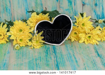 The heart shape on wood with flowers