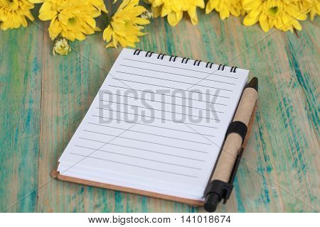 Blank mock up note book on wood