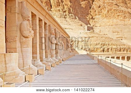Statues on facade of palace of Hatshepsut in Luxor, Egypt