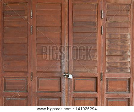 padlock and old door hasp and door on an vintage