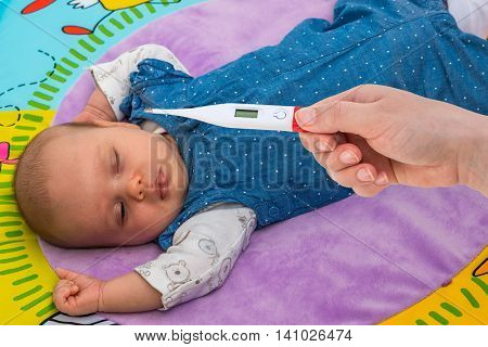Measuring Temperature To A Baby With Thermometer