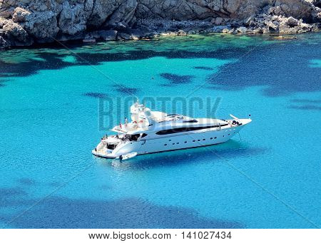 Luxury boat anchored in a bay, luxury yacht