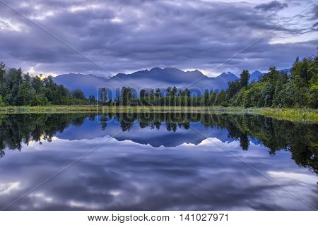Southern Alps reflected in Lake Kaniere South Island New Zealand