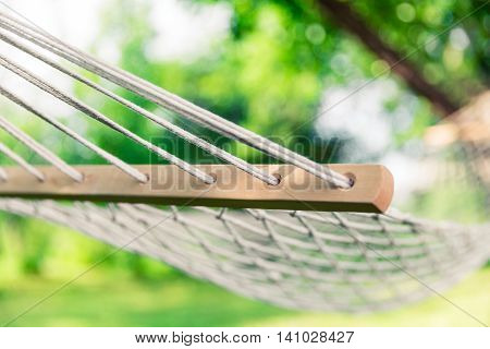 White hammock among the trees at summer day