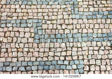 Horizontally oriented cobblestone background. Natural stone texture