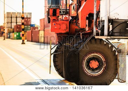 Containers with forklift car. Cargo in harbour with transport vehicle. Maritime transportation commerce concept.