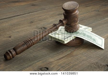 Stack Of Banknotes With Judges Or Auctioneers Gavel Or Hammer