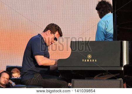 MOSCOW - AUGUST 01, 2016: Piano player Denis Matsuev performs at open air free entrance concert at VDNH park in Moscow. Celebration of VDNH foundation anniversary (77 years).