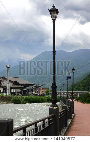Embankment Of A Mountain River On Alpine Resort