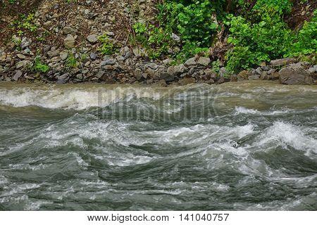 Flow Mountain River In Rocky Shores Landscape