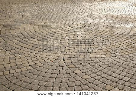 Background Of Modern  Cobblestone Paving In Perspective With Circular Pattern