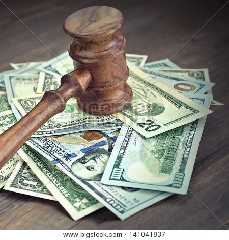 Heap Of Dollars With Judges Or Auctioneers Gavel Or Hammer