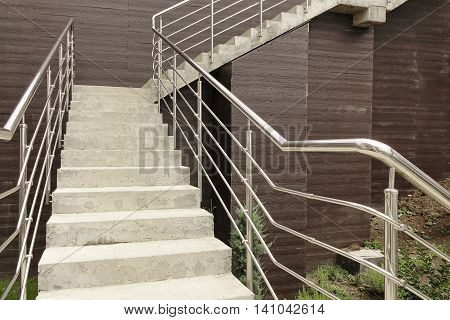 Outdoor Concrete Staircase With Stainless Steel Handrail Front View Close Up