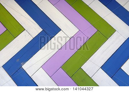 Wooden Multicolored Panel Background Or Texture With Herringbone  Pattern