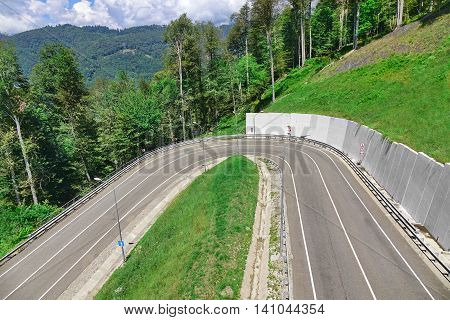Mountain Asphalt Road With Dangerous Turn On 180 Degrees Top View Sochi Roadway To Roza Khutor Plateau Alpine Ski Resort