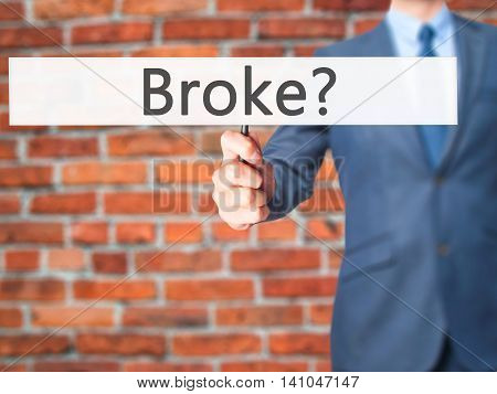 Broke - Businessman Hand Holding Sign