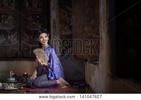 Beautiful Thai girl in Thai traditional costume. Ayuttaya style.
