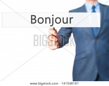 Bonjour (good Morning In French) - Businessman Hand Holding Sign