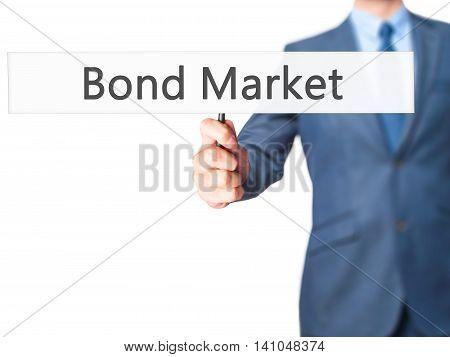 Bond Market - Businessman Hand Holding Sign