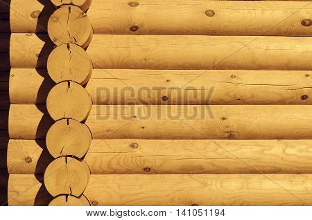 Natural background pattern of a log wall closeup