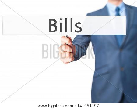 Bills - Businessman Hand Holding Sign