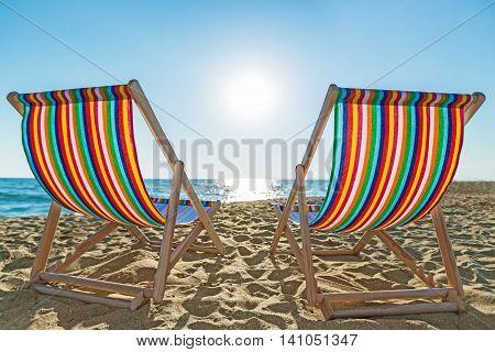 Couple of beach chairs on the sandy beach
