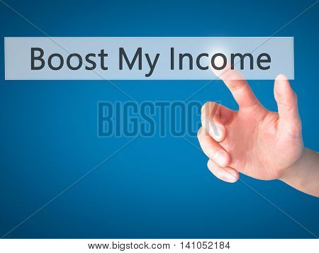Boost My Income - Hand Pressing A Button On Blurred Background Concept On Visual Screen.