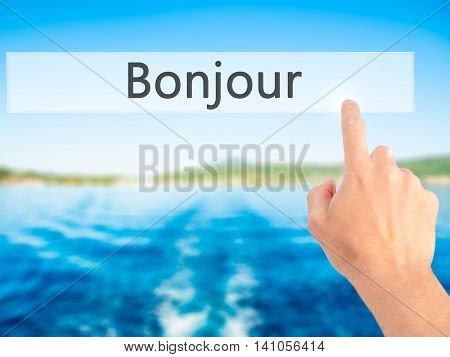 Bonjour (good Morning In French) - Hand Pressing A Button On Blurred Background Concept On Visual Sc