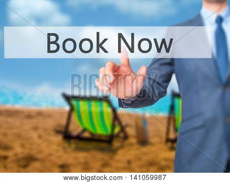 Book Now - Businessman Hand Touch  Button On Virtual  Screen Interface