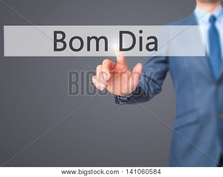 Bom Dia (in Portuguese - Good Morning) - Businessman Hand Touch  Button On Virtual  Screen Interface