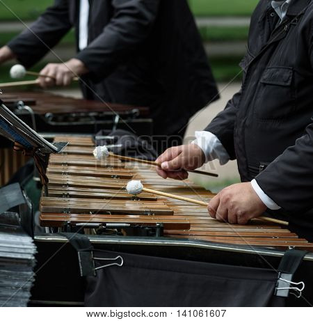Close up of the musician playing on xylophone.