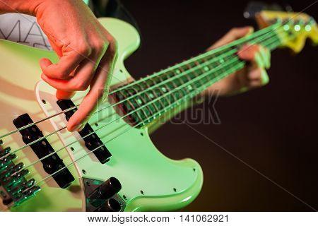 Closeup of a Musician Playing an Electric Bass