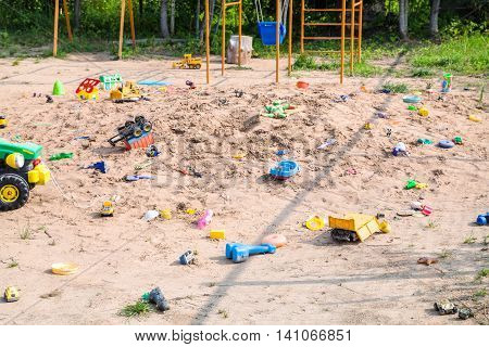 Forgotten Toys In Outdoor Sand Playground