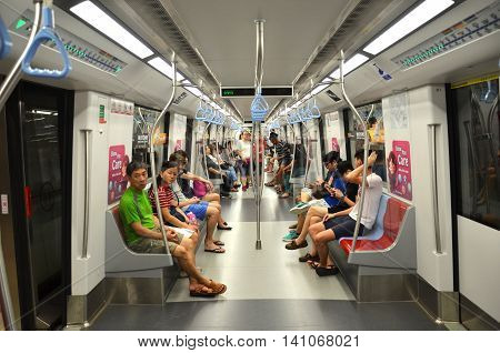 SINGAPORE - 30 JULY 2016: Downtown Line MRT train. There will be 12 Downtown Line stations from Bukit Panjang to Rochor that will open on Dec 27 2015.